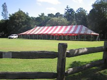 red and white peg and pole marquee hire